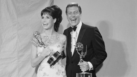 """Moore and Van Dyke hold Emmy Awards in 1966. Moore won two Emmys for """"The Dick Van Dyke Show"""" and four for """"The Mary Tyler Moore Show."""""""