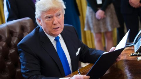 WASHINGTON, DC - JANUARY 24: US President Donald Trump speaks after signing executive orders related to the oil pipeline industry in the Oval Office of the White House January 24, 2017 in Washington, DC. President Trump has a full day of meetings including one with Senate Majority Leader Mitch McConnell and another with the full Senate leadership. (Photo by Shawn Thew-Pool/Getty Images)
