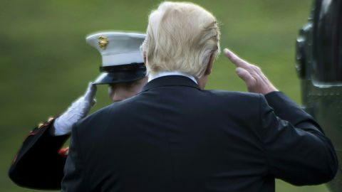 US President Donald Trump salutes as he boards Marine One for his first trip to Philadelphia as president, on the South Lawn of the White House January 26, 2017 in Washington, DC. / AFP / Brendan Smialowski        (Photo credit should read BRENDAN SMIALOWSKI/AFP/Getty Images)