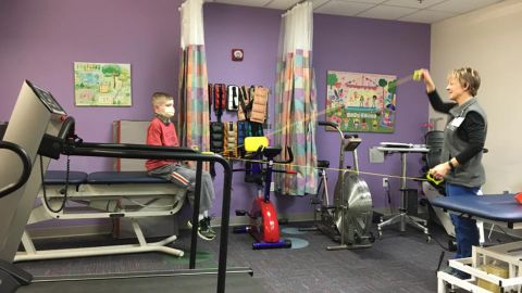January 2017:  Three times a week, Spencer does physical therapy at St. Louis Children's Hospital. Pictured with Spencer is Carol Hyde, PT, who has been working with Spencer prior to his transplant.