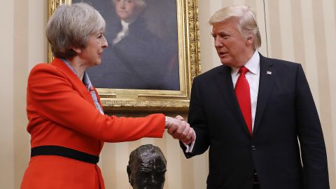 President Donald Trump shakes hands with British Prime Minister Theresa May in the Oval Office of the White House in Washington.