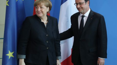 BERLIN, GERMANY - JANUARY 27:  French President Francois Hollande and German Chancellor Angela Merkel depart after speaking to the media prior to talks at the Chancellery on January 27, 2017 in Berlin, Germany. The two leaders are meeting in Berlin on the same day that British Prime Minister Theresa May is meeting new U.S. President Donald Trump for the first time in Washington, D.C.  (Photo by Sean Gallup/Getty Images)