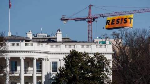 """Seven activists affiliated with the environmental organization Greenpeace climbed a construction crane near the White House and <a href=""""http://www.cnn.com/2017/01/25/politics/greenpeace-resist-crane-white-house/"""" target=""""_blank"""">unfurled a """"resist"""" banner</a> to protest Donald Trump's presidency on Wednesday, January 25."""