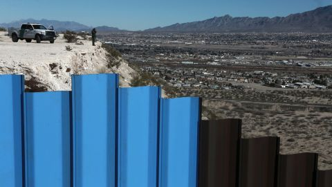 """A border-patrol agent stands near a fence separating Juarez, Mexico, from Sunland Park, New Mexico, on Wednesday, January 25. President Trump <a href=""""http://www.cnn.com/2017/01/25/politics/donald-trump-build-wall-immigration-executive-orders/index.html"""" target=""""_blank"""">has promised to build a border wall </a>between Mexico and the United States."""
