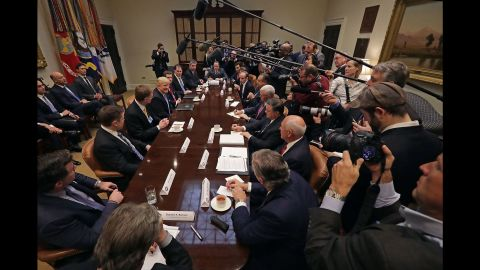 """Business leaders meet with Trump and Vice President Mike Pence at the White House on Monday, January 23. Trump <a href=""""http://www.cnn.com/2017/01/23/politics/trump-business-leaders-border-tax/"""" target=""""_blank"""">promised the group</a> that he planned to cut corporate taxes """"massively"""" and slash regulations to give companies incentives to stay in the United States. But he also warned them they would face a steep border tax if they take their manufacturing abroad."""