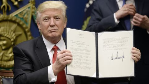 """ARLINGTON, VA - JANUARY 27: U.S. President Donald Trump signs executive orders in the Hall of Heroes at the Department of Defense on January 27, 2017 in Arlington, Virginia. Trump signed two orders calling for the """"great rebuilding"""" of the nation's military and the """"extreme vetting"""" of visa seekers from terror-plagued countries. (Photo by Olivier Douliery-Pool/Getty Images)"""