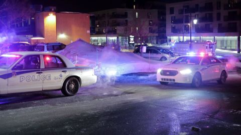 """Police survey the scene after deadly shooting at a mosque in Quebec City, Canada, Sunday, Jan. 29, 2017. Quebec Premier Philippe Couillard termed the act """"barbaric violence"""" and expressed solidarity with victims' families. (Francis Vachon/The Canadian Press via AP)"""