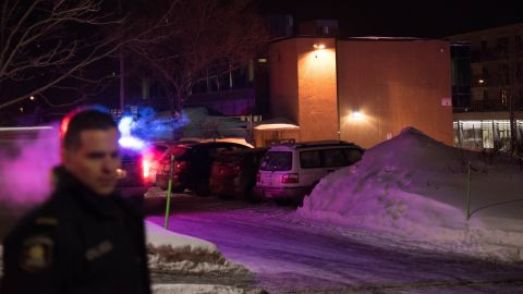 Canadian police officers respond to a shooting in a mosque at the Québec City Islamic cultural center on Sainte-Foy Street in Quebec city on January 29, 2017.Two arrests have been made after five people were reportedly shot dead in an attack on a mosque in Québec City, Canada.  / AFP / Alice Chiche        (Photo credit should read ALICE CHICHE/AFP/Getty Images)
