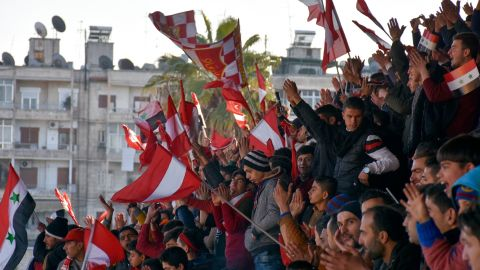 Al-Ittihad supporters wave flags bearing the team colors during the Syrian league football match between derby rivals Al-Ittihad and Al-Hurriya, on January 28, 2017, in the northern Syrian city of Aleppo. The Ittihad club beat Hurriya 2-1 in their first match on home turf since rebels took east Aleppo in 2012, dividing the northern city into a regime-held west and rebel-controlled east. / AFP / George OURFALIAN        (Photo credit should read GEORGE OURFALIAN/AFP/Getty Images)
