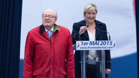 National Front founder Jean-Marie Le Pen stands in front of his daughter Marine Le Pen, president of the party.