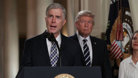 WASHINGTON, DC - JANUARY 31:  Judge Neil Gorsuch (L) speaks to the crowd as his wife Louise (R) looks on after U.S. President Donald Trump (2nd L) nominated him to the Supreme Court during a ceremony in the East Room of the White House January 31, 2017 in Washington, DC. (Photo by Alex Wong/Getty Images)