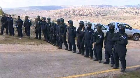 A line of Israeli security forces prevent further right wing protesters from entering the Amona settlement.