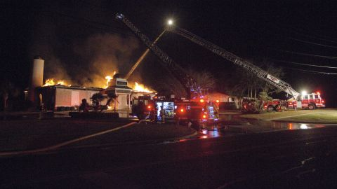 Firefighters respond to a fire at the Islamic Center of Victoria on Saturday, Jan. 28, in Victoria, Texas.