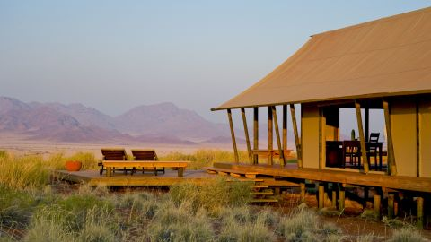 Namibia has stunning scenery such as this private reserve where visitors can see giraffes and other animals.