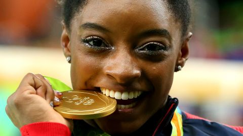 RIO DE JANEIRO, BRAZIL - AUGUST 11:  Gold medalist Simone Biles of the United States poses for photographs after the medal ceremony for the Women's Individual All Around on Day 6 of the 2016 Rio Olympics at Rio Olympic Arena on August 11, 2016 in Rio de Janeiro, Brazil.  (Photo by Alex Livesey/Getty Images)