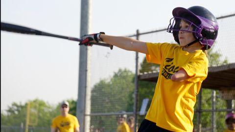 Jordan is an athlete; she's shown here taking a swing on the baseball field.
