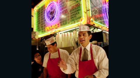 Los Angeles mayoral candidate Antonio Villaraigosa takes orders for tacos in the Grand Central Market on election day, June 5, 2001 in Los Angeles, CA. Villaraigosa, who lost the election to rival James Hahn, had hoped to become the first latino mayor of Los Angeles, whose population is nearly one-half hispanic, since 1872. (Photo by David McNew/Getty Images)