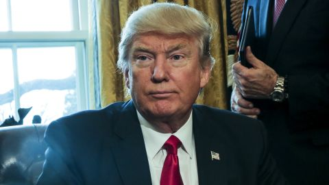 U.S. President Donald Trump poses after signing Executive Orders in the Oval Office of the White House, including an order to review the Dodd-Frank Wall Street to roll back financial regulations of the Obama era February 3, 2017 in Washington, DC.