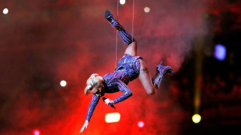 """At the beginning of the show, Gaga appeared to sing """"God Bless America"""" from the roof of Houston's NRG Stadium. Then she jumped down to the stage area."""