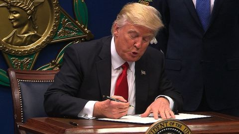 donald trump signs travel order