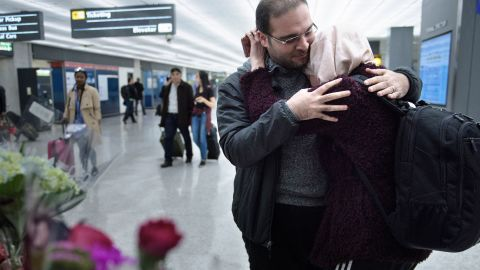 Dr. Muhamad Alhaj Moustafa, a Syrian citizen, embraces his wife Nabil Alhaffar, also a  Syrian citizen, after she returned from a trip to Doha but was denied re-entry in January, at the international arrivals hall at Washington Dulles International Airport February 6, 2017 in Dulles, Virginia.