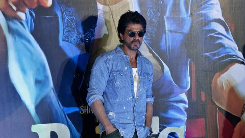 """Shah Rukh Khan poses for press during a trailer launch of """"Raees"""" in Mumbai in December 2016."""