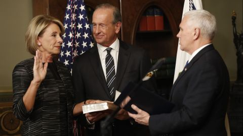 """Pence swears in Education Secretary Betsy DeVos next to her husband, Dick, on Tuesday, February 7. Pence <a href=""""http://www.cnn.com/2017/02/07/politics/betsy-devos-senate-vote/"""" target=""""_blank"""">cast a historic tie-breaking vote</a> to confirm DeVos after the Senate was divided 50-50."""