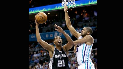 At 40 years old, San Antonio Spurs player Tim Duncan, left, retired in 2016 with five NBA championships.
