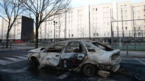 A burned-out car torched in protests.