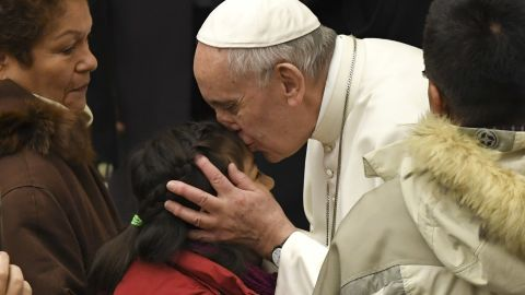 Pope Francis kisses a child during a general audience at the Paul VI Audience Hall at the Vatican on February 8.