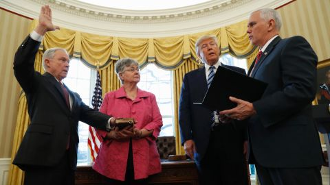 """Trump watches as Pence administers the oath of office to Attorney General Jeff Sessions in the White House Oval Office on Thursday, February 9. Sessions, one of Trump's closest advisers and his earliest supporter in the Senate, was confirmed <a href=""""http://www.cnn.com/2017/02/08/politics/jeff-sessions-vote-senate-slog/"""" target=""""_blank"""">by a 52-47 vote</a> that was mostly along party lines. He was accompanied to the swearing-in by his wife, Mary."""