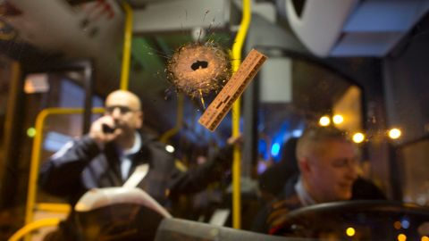 A bullet hole is seen on the windshield of a bus at the scene of a shooting attack in Petah Tikva, Israel, Thursday, Feb. 9, 2017. (AP Photo/Oded Balilty)