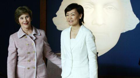 First lady Laura Bush, and Akie Abe, wife of Japanese Prime Minister Shinzo Abe, tour Mount Vernon estate.