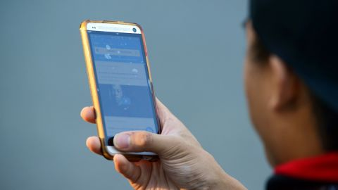 Checking social media on a smartphone in Seattle, Washington.