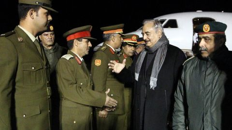 Gen. Haftar, second right,  is greeted upon his arrival at Al-Kharouba airport on December 3, 2016 after a visit to Russia.