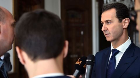 A handout picture released by the official Syrian Arab News Agency (SANA) on February 7, 2017 shows Syrian President Bashar al-Assad (R) giving an interview to a Belgian media outlet.    / AFP PHOTO / SANA / --/AFP/Getty Images