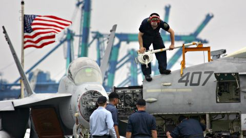 PORT KLANG, MALAYSIA:  US Navy maintenance crew work on the radome of an F/A-18 Hornet strike aircraft on board the US aircraft carrier Nimitz in Port Klang, 30 June 2005. The USS Nimitz, the world's largest nuclear-powered aircraft carrier with a length of nearly 1,100 feet (340m) and a displacement over 95,000 tons, is in Malaysia for a scheduled port call until 04 July 2005. AFP PHOTO/TENGKU BAHAR  (Photo credit should read TENGKU BAHAR/AFP/Getty Images)