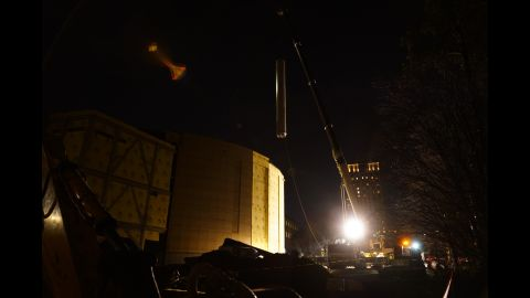 The Civil War painting's second spool is lifted to the roof of the Atlanta History Center's cyclorama wing.
