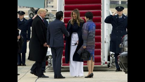 The first lady shakes hands with Japanese Prime Minister Shinzo Abe before boarding Air Force One with her husband in February 2017. The Trumps hosted the Abes at their Mar-a-Lago estate in Palm Beach, Florida.
