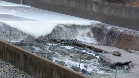 Chunks of concrete are seen breaking off in the dam's primary spillway on Tuesday, February 7. Lake Oroville managers stopped sending water over the spillway Tuesday after noticing the damage caused by erosion.