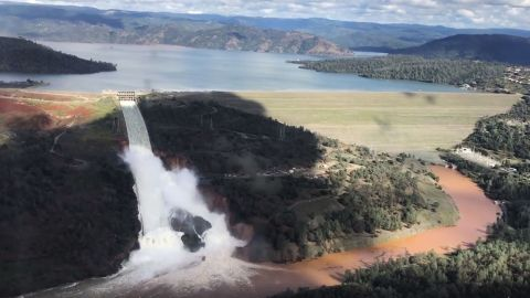 Water flows over an emergency spillway of the Oroville Dam in Oroville, Calif. on Feb. 10