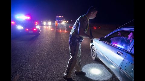 California Highway Patrol officer Ken Weckman directs evacuation traffic in Marysville, California on Sunday, February 12. An evacuation order was issued for several Northern California counties after heavy rainfall filled Lake Oroville to the verge of overflow.