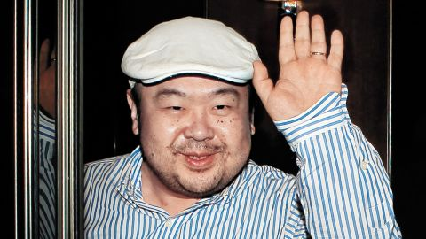 """In a picture taken on June 4, 2010 Kim Jong-Nam, the eldest son of North Korean leader Kim Jong-Il, waves after an interview with South Korean media representatives in Macau.  Kim Jong-Nam was in the limelight with Seoul's JoongAng Ilbo newspaper carrying a snatched interview with him at a hotel in Macau. Jong-Nam declined knowledge of the warship incident, it reported, and said his father is """"doing well"""".  North Korean Leader  Leader Kim Jong-Il on June 7 attended a rare second annual session of parliament at which Kim's brother-in-law was promoted and the country's prime minister was sacked, state media reported.  REPUBLIC OF KOREA OUT  AFP PHOTO / JOONGANG SUNDAY VIA JOONGANG ILBO (Photo credit should read JoongAng Sunday/AFP/Getty Images)"""