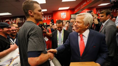 Tom Brady celebrates with New England Patriots owner Robert Kraft in the locker room after defeating the Atlanta Falcons during Super Bowl 51 on February 5, 2017 in Houston, Texas.