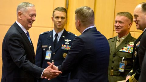 U.S. Secretary of Defense Jim Mattis (L) speaks with members of his delegation prior to a meeting at NATO headquarters in Brussels on February 15, 2017.  NATO allies meet new US Defence Secretary James Mattis for the first time in Brussels seeking reassurance over President Donald Trump's commitment but bracing for military spending demands. / AFP / POOL / Virginia Mayo        (Photo credit should read VIRGINIA MAYO/AFP/Getty Images)
