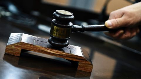 A Chinese judge uses a gavel to strike the pad during a trial at the Yunyang People's Court in Yunyang county, Chongqing, China, 29 October 2015.