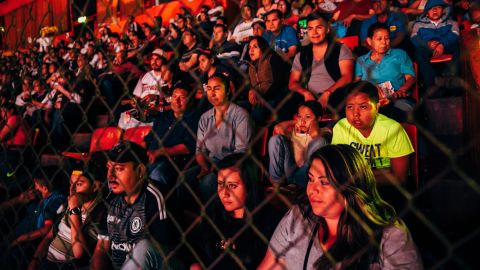 Fans watch the Lucha Libre match at Arena Mexico on Sunday, February 12.