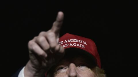 TOPSHOT - US Republican presidential nominee Donald Trump addresses a campaign rally at Atlantic Aviation in Moon Township, Pennsylvania on November 6, 2016. / AFP / MANDEL NGAN        (Photo credit should read MANDEL NGAN/AFP/Getty Images)