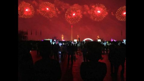 North Korean soldiers watch fireworks on February 16, in Pyongyang.