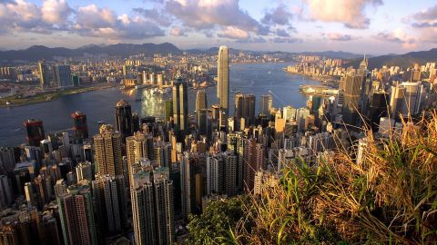 """This general view from """"The Peak"""" shows Hong Kong's latest addition to its skyline, the newly completed 88-storey Two IFC building (C), towering above the city, 12 July 2003. Two IFC, which is the third tallest building in the world behind the Sears Tower in Chicago and the Petronas Towers in Kuala Lumpur, is expected to open for business in a month.     AFP PHOTO/Richard A. BROOKS   (Photo credit should read RICHARD A. BROOKS/AFP/Getty Images)"""
